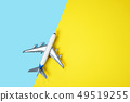 Model plane airplane or plane on yellow and blue background. 49519255