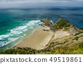 Coastline view from Cape Reinga with blue sky and white clouds above, Northland, New Zealand 49519861