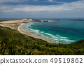 Coastline view from Cape Reinga with blue sky and white clouds above, Northland, New Zealand 49519862
