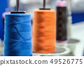 different color threads on the sewing machine  49526775