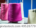 different color threads on the sewing machine  49526779
