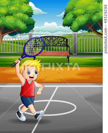 Happy boy playing tennis at the courts 49529298