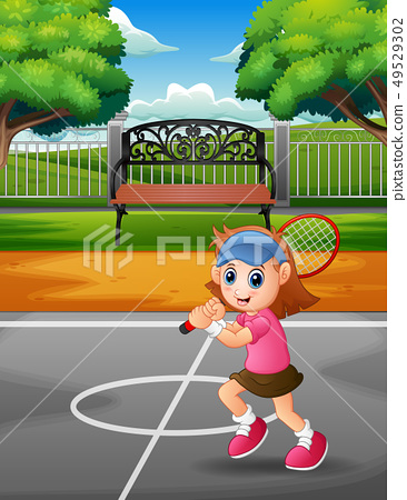 Happy girl playing tennis at the courts 49529302