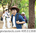 happy asian man with backpack hiking in  forest 49531368