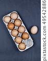 Farm chicken eggs in cardboard container. 49542886