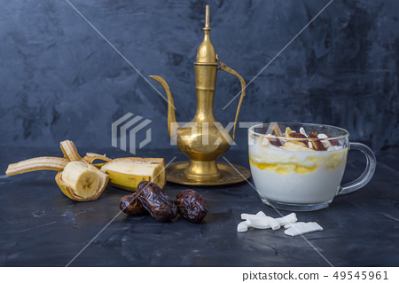 Iftar or Suhoor snack  of dates with yogurt   49545961