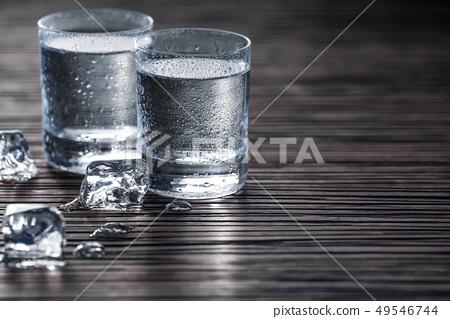 Vodka poured in shots,selective focus 49546744