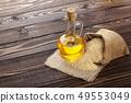 sesame oil in glass bottle 49553049