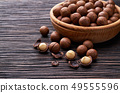 Macadamia nuts in wooden bowl   on brown wooden 49555596