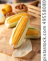 Close up shot Fresh ripe and peeled sweet corn 49558080