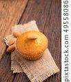 Close up a cup of almond cake against sack fabric 49558086
