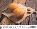 Close up a cup of almond cake against sack fabric 49558088