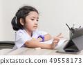 Asian little girl in student uniform doing 49558173