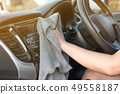 Hands of woman using microfiber fabric to clean up 49558187