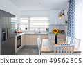Modern kitchen interior with dining table 49562805