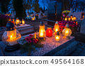 Colorful candles on the cemetery at All Saints 49564168