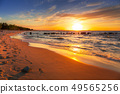 Amazing sunset at Baltic sea beach in Poland 49565256
