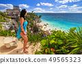 Woman at beautiful Tulum beach by Caribbean sea, 49565323