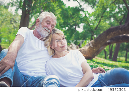 Portrait of a happy senior couple in park 49572508