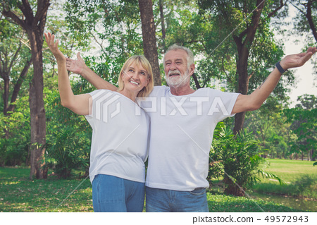 Mature couple resting in park 49572943