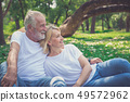 Elderly couple resting in the park 49572962