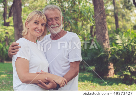 Happy old couple relax in the park. 49573427