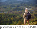Man tourist looks at the sunrise on the volcano Batur on the island of Blai in Indonesia. Hiker man 49574506
