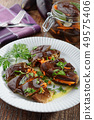 Marinated eggplant appetizer stuffed with carrot, 49575406