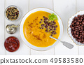 Vegetable vegetarian carrot pumpkin soup cream with red beans 49583580