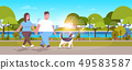 fat obese couple walking with husky dog overweight man woman having fun outdoor city urban park 49583587
