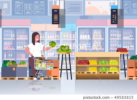 fat obese woman with shopping trolley cart choosing vegetables and fruits weight loss concept 49583815
