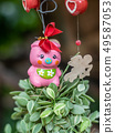 Mobile doll hanging in garden for decoration. 49587053