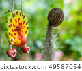 Mobile doll hanging in garden for decoration. 49587054