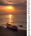 Kayak on beach in morning. 49587055