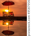 Sunrise with orange morning sky with chair. 49587056