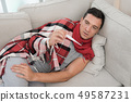 Man with Cold Sitting on Sofa in Checkered Blanket 49587231