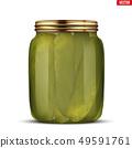 Pickled cucumbers in glass jar 49591761