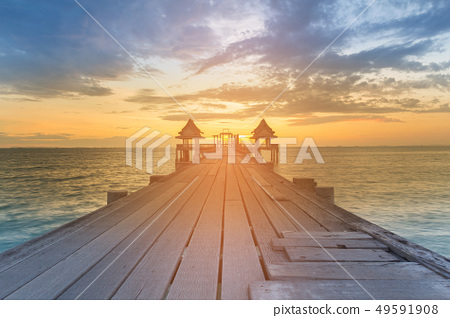 Wooden walking path leading to sunset seacoast  49591908