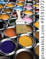 Paint can with a paintbrush 49591972