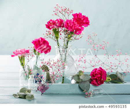 Bouquet of pink carnation on light turquoise wooden background 49593135