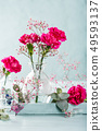 Bouquet of pink carnation on light turquoise wooden background 49593137