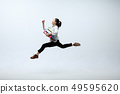 Woman working at office and jumping isolated on studio background 49595620