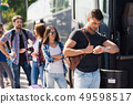 Group of Young People Boarding on Travel Bus 49598517