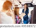 Female Tour Service Employee at Work on Tour Bus 49598972