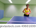 Mature beautiful woman playing table tennis indoors 49601699