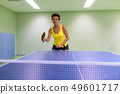 Mature beautiful woman playing table tennis indoors 49601717