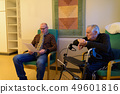 Mature man and senior man together at nursing home in Turku, Fin 49601816