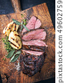 Barbecue roast boar with quinces  49602759
