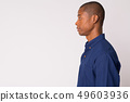 Closeup profile view of young handsome bald African businessman 49603936