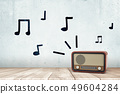 3d rendering of a retro radio receiver on a wooden surface and hand-drawn musical notes on the wall. 49604284